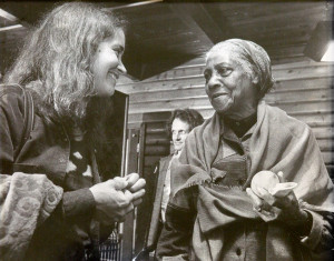 Linda Waterfall and Elizabeth Cotton at Puget Sound Guitar Workshop, 1985. In the background, Mike Seeger.